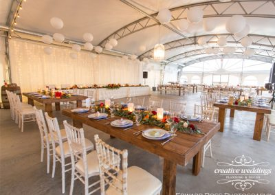 Tented Wedding, Rocking R Guest Ranch Wedding, Strathmore Wedding, Creative Weddings Planning & Decor, Harvest Tables, King's Tables, limewash Chiavari chairs, paper lanterns, Bespoke wedding, Edward Ross Photography, marsala, dusty blue