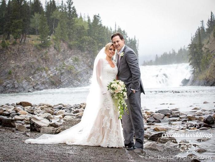Banff Wedding Planner Creative Weddings Planning & Decor; Bow Falls wedding photos; Banff Real Wedding; Rimrock Resort Wedding; Eric Daigle Photography