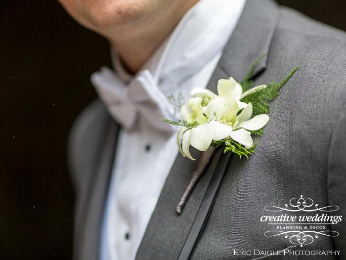 Banff Wedding Florist - Orchid Boutonniere by Wedding Flowers With Love By Fiori Con Amore; Banff Wedding Planner - Creative Weddings Planning & Decor; Rimrock Resort Wedding; Eric Daigle Photography