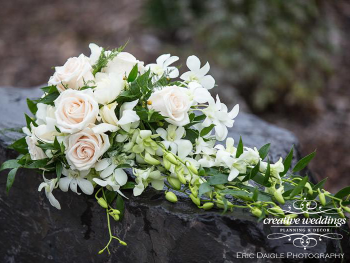 Banff Wedding Florist - Cascading white bouquet with greenery; Wedding Flowers With Love By Fiori Con Amore; Banff Wedding Planner - Creative Weddings Planning & Decor; Rimrock Resort Wedding; Eric Daigle Photography