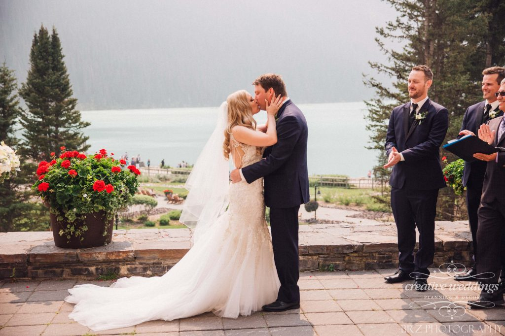 First Kiss, Husband and wife, newlyweds, outdoor wedding, Chateau Lake Louise Wedding, Real Wedding, Creative Weddings Planning & Design